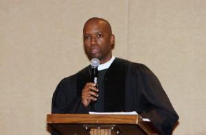 pastor preaches